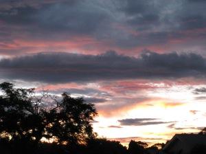 And evening shadows fall across the sky.