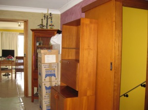 Boxes and furniture put wherever they would fit.